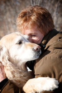 Kayla-the-golden-retriever-giving-her-person-Shelly-a-hug