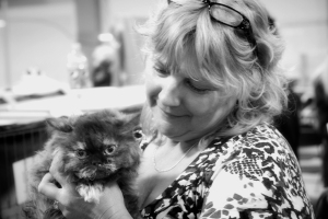 Black-and-White-photo-of-Cyndi-holding-Hannah-Montana-a-beautiful-chocolate-tortie-selkirk-rex-cat